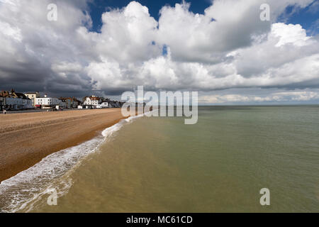 View from Deal Pier looking towards Thanet with large clouds and soft light falling on the shingle beach. Kent, UK. - Stock Photo