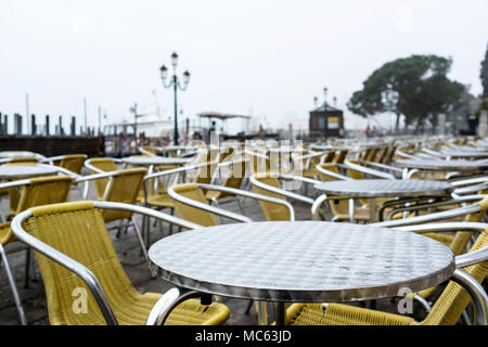 Abandoned chairs of a cafe on a rainy day in Venice, Italy, 2018 - Stock Photo