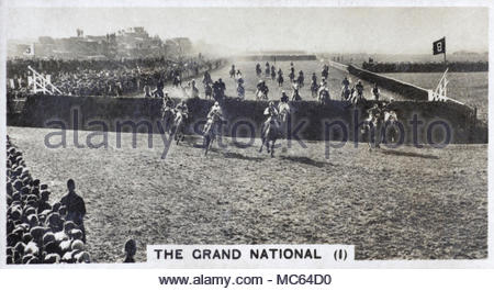 The Grand National - Crowds watch horses jumping over Becher's Brook, Aintree Racecourse 1932 - Stock Photo