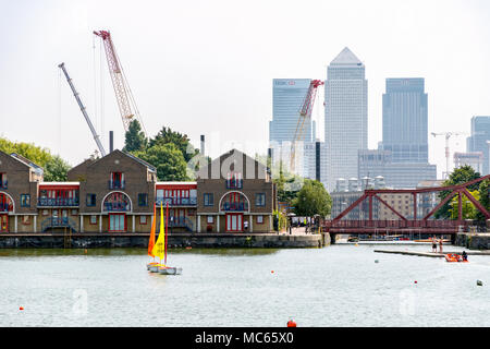 London, UK - June 21, 2018 - Skyscrapers in Canary Wharf seen from Shadwell Basin - Stock Photo
