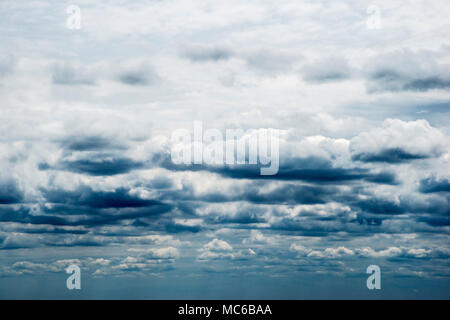 Multiple layers of ominous storm clouds. - Stock Photo