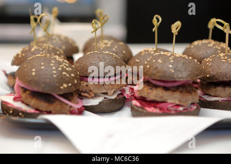 Black hamburger juicy beef burger with  onion on the plate - Stock Photo