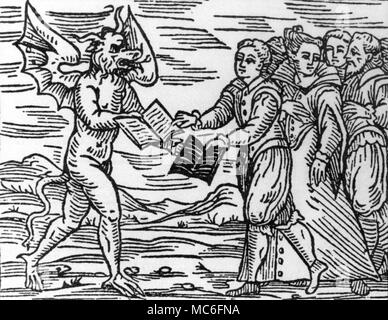 The Devil exchanging the Christian 'Book of Life' for the diabolical 'Book of Death' (printed on black vellum) with his newly induced witches.  Woodcut from Francesco-Maria Guazzo, Compendium Maleficarum, 1626 edition. - Stock Photo