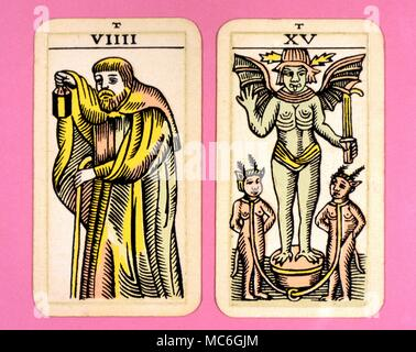 Tarot Cards-Majo Arcana- The Parisian Tarot.  Card 9, The Hermit, and Card 15. The Devil Two cards from a  Major Arcana picture Tarot, probably designed in an archaizing style in loose imitation of the Rosicrucian deck designed by Pamela Coleman Smith, alongside A.E.Waite, and various earlier decks, such as that published by Encausse (Papus) in The Tarot of the Bohemians at the end of the 19th century, post 1905, but earlier than 1912. The name Parisian Tarot was given by the owner of the deck - it might however be called the Tau Tarot, from the intriguing letter Tau at the head of each card. - Stock Photo