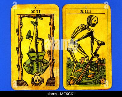Tarot Cards-Majo Arcana- The Parisian Tarot. Card 10. The Wheel of Fortune, and Card 11. The Strength. Two cards from a  Major Arcana picture Tarot,adapted by a Wiccan group. Probably designed in an archaizing style in loose imitation of the Rosicrucian deck designed by Pamela Coleman Smith, alongside A.E.Waite, and various earlier decks, such as that published by Encausse (Papus) in The Tarot of the Bohemians at the end of the 19th century, post 1905, but earlier than 1912. The name Parisian Tarot was given by the owner of the deck - it might however be called the Tau Tarot, from the intrigui - Stock Photo