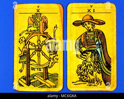 Tarot Cards-Majo Arcana- The Parisian Tarot. Card 10. The Wheel of Fortune, and Card 11. The Strength. Two cards from a  Major Arcana picture Tarot, probably designed in an archaizing style in loose imitation of the Rosicrucian deck designed by Pamela Coleman Smith, alongside A.E.Waite, and various earlier decks, such as that published by Encausse (Papus) in The Tarot of the Bohemians at the end of the 19th century, post 1905, but earlier than 1912. The name Parisian Tarot was given by the owner of the deck - it might however be called the Tau Tarot, from the intriguing letter Tau at the head  - Stock Photo