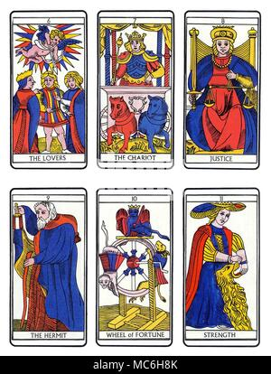 TAROT CARDS - MODERN MARSEILLES DECK Six cards from a complete sequence of Tarot cards in the Marseilles tradition. Top, from left to right -  The Lovers, The Chariot, Justice, The Hermit, Wheel of Fortune and Strength. - Stock Photo