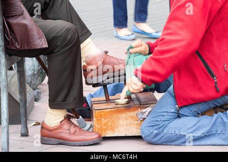 Shoe shiner in Spain - Stock Photo