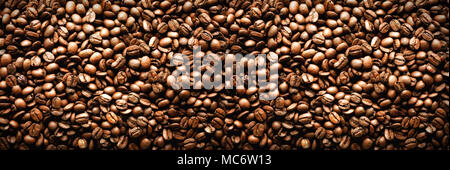 Roasted coffee beans backgound, copy space, top view. Cappuccino, dark espresso, aroma black caffeine drink, ingredient for coffee beverage. Banner. - Stock Photo