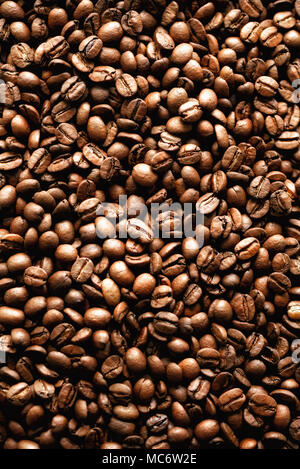 Roasted coffee beans backgound, copy space, top view. Cappuccino, dark espresso, aroma black caffeine drink, ingredient for coffee beverage - Stock Photo