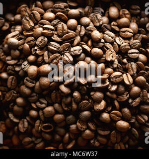 Roasted coffee beans backgound, copy space, top view. Cappuccino, dark espresso, aroma black caffeine drink, ingredient for coffee beverage. Square cr - Stock Photo