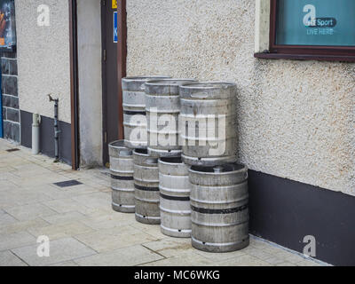 Empty beer barrels awaiting collection outside a pub - Stock Photo