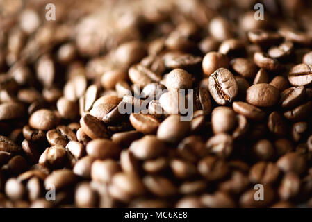 Roasted coffee beans backgound, copy space, top view. Cappuccino, dark espresso, aroma black caffeine drink, ingredient for coffee beverage. Macro sho - Stock Photo