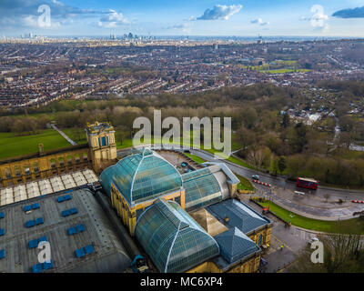 London, England - Aerial skyline view of north London with red double decker bus, taken from Alexandra Park at Muswell Hill. This view includes Alexan - Stock Photo