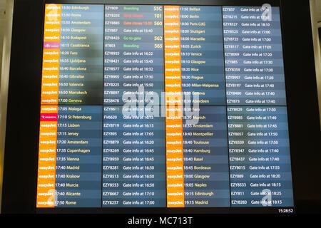 Flight departure board London Gatwick Airport, LGW, England, United Kingdom. - Stock Photo