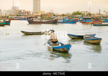 Fishing boats on the Cai River, a Tributary off the South China Sea, Nha Trang, Vietnam - Stock Photo