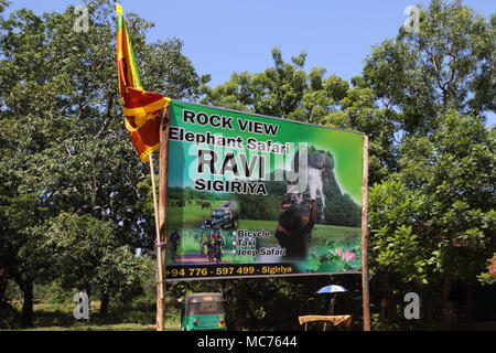 North Central Province Sri Lanka Road Toward Giritale Billboard Advertising Rock View Elephant Safari  Ravi Sigiriya - Stock Photo