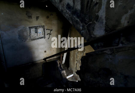 Beirut, Lebanon. 11th Apr, 2018. A general view of a damaged staircase inside a building, located on the Green Line, which was an area used as a line of demarcation to separate the predominantly Muslim west areas from the predominantly Christian east areas during the Lebanese Civil War, in Beirut, Lebanon, 11 April 2018. The Lebanese Civil War started on 13 April 1975 and ended on 13 October 1990, during which at least 150,000 people were killed, and at least one million others fled the country. Credit: Marwan Naamani/dpa/Alamy Live News - Stock Photo