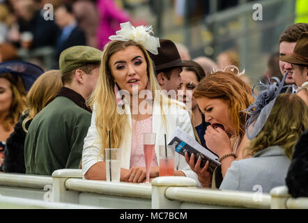 Aintree, Liverpool, Merseyside, UK. 13th April 2018, Aintree Racecourse, Liverpool, England; The Randox Health Grand National 2018; Race goers enjoying Ladies Day at the 2018 Grand National Credit: News Images/Alamy Live News - Stock Photo