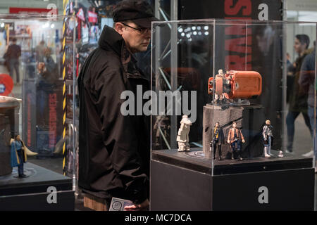 Barcelona, Catalonia, Spain. 13th Apr, 2018. A visitor is seen observing the Transformers Marvel miniatures. The 36th Barcelona International Comic Fair from 12th-15th April 2018 in Fira Barcelona Montjuïc. Credit: Paco Freire/SOPA Images/ZUMA Wire/Alamy Live News - Stock Photo