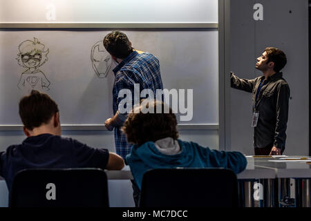 Barcelona, Catalonia, Spain. 13th Apr, 2018. Two cartoonists are seen during a class for school children. The 36th Barcelona International Comic Fair from 12th-15th April 2018 in Fira Barcelona Montjuïc. Credit: Paco Freire/SOPA Images/ZUMA Wire/Alamy Live News - Stock Photo
