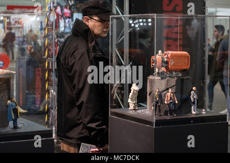 Barcelona, Spain. 13th Apr, 2018. A visitor is seen observing the Transformers Marvel miniatures. The 36th Barcelona International Comic Fair from 12th-15th April 2018 in Fira Barcelona Montjuïc. Credit: SOPA Images Limited/Alamy Live News - Stock Photo