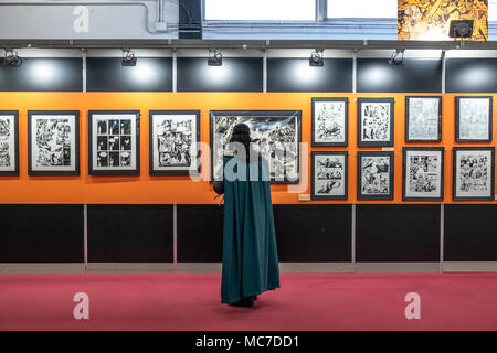 Barcelona, Spain. 13th Apr, 2018. A visitor dressed as a comic character visits one of the exhibition rooms. The 36th Barcelona International Comic Fair from 12th-15th April 2018 in Fira Barcelona Montjuïc. Credit: SOPA Images Limited/Alamy Live News - Stock Photo