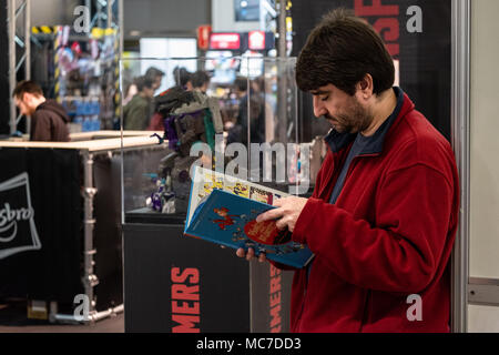 Barcelona, Spain. 13th Apr, 2018. A visitor to the comic lounge carefully reads one of the copies for sale. The 36th Barcelona International Comic Fair from 12th-15th April 2018 in Fira Barcelona Montjuïc. Credit: SOPA Images Limited/Alamy Live News - Stock Photo
