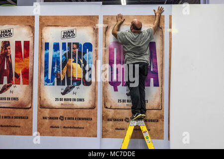 Barcelona, Catalonia, Spain. 13th Apr, 2018. An operator is seen on a staircase making the last arrangements of the comic fair. The 36th Barcelona International Comic Fair from 12th-15th April 2018 in Fira Barcelona Montjuïc. Credit: Paco Freire/SOPA Images/ZUMA Wire/Alamy Live News - Stock Photo