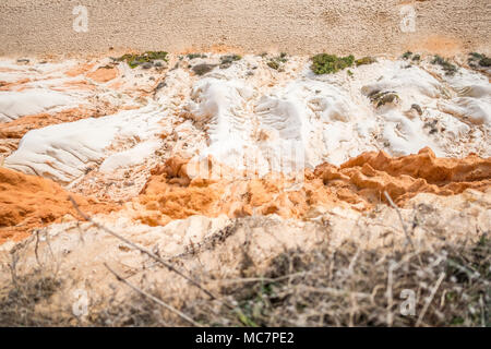 Looking down to beautiful cliffs along Falesia Beach in Albufeira, Algarve, Portugal - Stock Photo