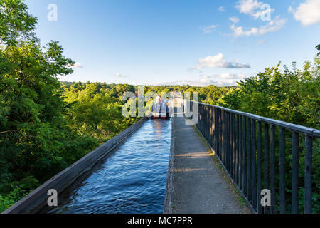 Near Froncysyllte, Wrexham, Wales, UK - August 30, 2016: People stering a Narrowboat over the Pontcysyllte Aqueduct, seen from the Froncysyllte side - Stock Photo