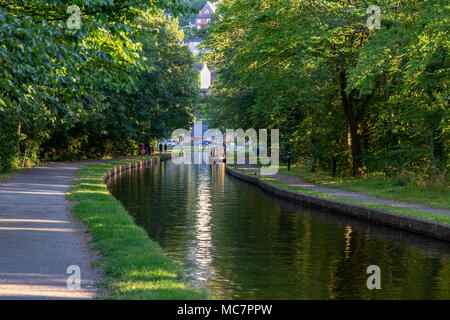Near Froncysyllte, Wrexham, Wales, UK - August 30, 2016: A Narrowboat on the shore of the Llangollen Canal, with people walking on the footpath - Stock Photo