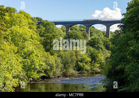 Pontcysyllte, Wrexham, Wales, UK - August 31, 2016: View from the Gate Road bridge at the River Dee, with people stering a Narrowboat - Stock Photo