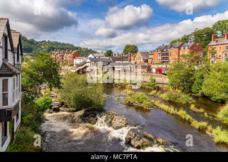 Llangollen, Denbighshire, Wales, UK - August 31, 2016: View from the Llangollen Bridge over the River Dee with the Railway Station in the background - Stock Photo