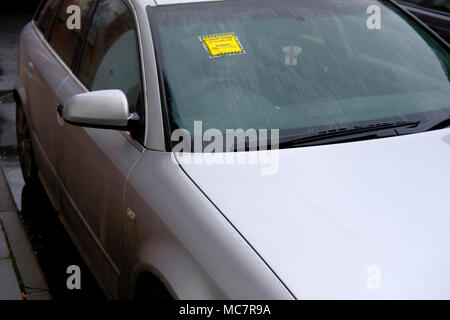 Penalty Charge for illegal parking. Parking ticket stuck on windscreen of a car - Stock Photo