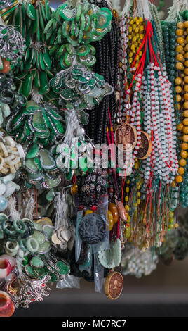 Chinese traditional accessories and popular authentic decorative elements in South East Asia. Outdoor souvenir market in Hong Kong. Travel concept. - Stock Photo
