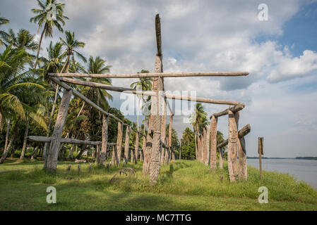 Hand carved poles of a collapsed ancient haus tambaran, Korogo Village, Middle Sepik, Papua New Guinea - Stock Photo