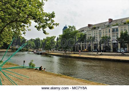 People relaxing along Erdre river in Nantes, Loire Atlantique, Pays de la Loire region, France - Stock Photo