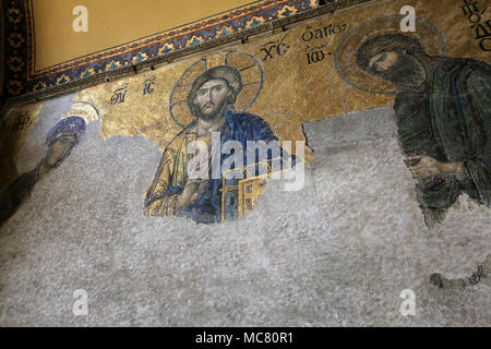 The Deësis mosaic, ancient Christian art showing Christ, Virgin Mary and John the Baptist, on the upper gallery inside Hagia Sophia in Istanbul - Stock Photo