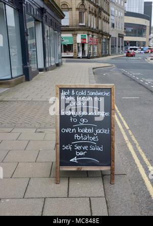 Pavement chalkboard advertising fresh coffee on street in Halifax west yorkshire - Stock Photo