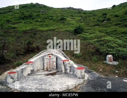 GRAVEYARD Chinese tombs.  The placing of Chinese tombs is determined strictly by Feng Shui considerations, as is their decoration.  Chinese burial ground near Hong Kong - Stock Photo