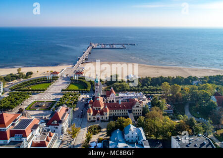 Sopot resort in Poland. SPA, old lighthouse, wooden pier (molo) with marina, yachts,  beach,  vacation infrastructure, park, promenade and walking peo - Stock Photo