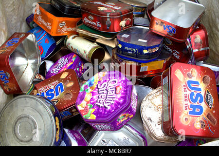 empty biscuit tins collected and bagged up ready to be recycled in a metal recycling plant. - Stock Photo