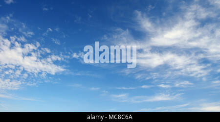 Cirrus clouds against the dark blue sky. Heavenly background. - Stock Photo