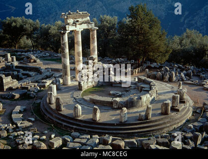 Greece. Sanctuary of the Athena Pronaia in Delphi. Tholos. Circular temple. 4th century BC. Remains of the three reconstructed Doric columns of the tholos. - Stock Photo