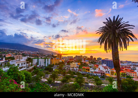 Puerto de la Cruz, Tenerife, Canary islands, Spain: Sceninc view over the city at the sunset time - Stock Photo