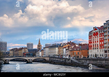 Church, Isere river and bridge in Grenoble, France - Stock Photo