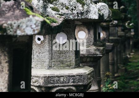 Japanese traditional stone lanterns in Nara, Japan - Stock Photo