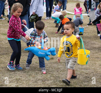 Service members and their families gathered for the Easter Eggstravaganza event at Marine Corps Air Station Cherry Point, N.C., March 24, 2018. The event featured Easter egg hunts, inflatable bounce houses, an obstacle course, food trucks, the Easter Bunny and more. The Eggstravaganza allowed service members and their families to enjoy a free day of fun on the air station. Approximately 2,000 to 3,000 people attended this year's Easter Eggstravaganza. - Stock Photo