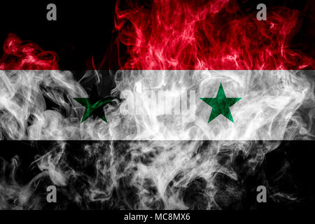 National flag of Syria from thick colored smoke on a black isolated background - Stock Photo
